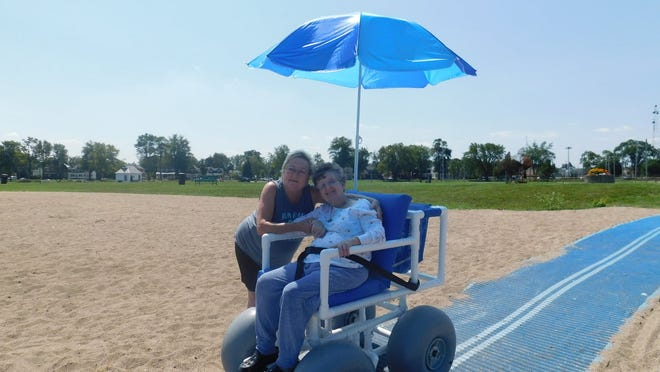 Sisters Cathy and Jaynie of Findlay recently became the first to utilize the all-terrain wheelchair at Port Clinton's city beach.
