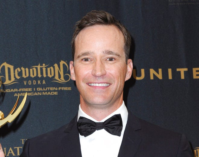 """FILE - Producer Mike Richards poses in the pressroom at the 43rd annual Daytime Emmy Awards on May 1, 2016, in Los Angeles. Richards is out as executive producer of """"Jeopardy!"""", days after he exited as the quiz show's newly appointed host because of past misogynistic and other comments. Richards is also no longer executive producer of """"Wheel of Fortune."""" (Photo by Richard Shotwell/Invision/AP, File)"""