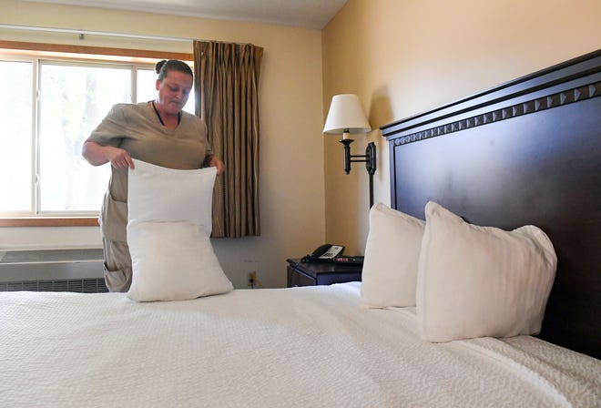 Head housekeeper Gerrie Sanders puts fresh pillowcases on the bed pillows in room 109 on Tuesday, August 31, 2021 at Valley Inn Hotel in Sioux Falls. The unique method of standing pillows on their ends along the headboard is her own personal touch to the rooms she services.