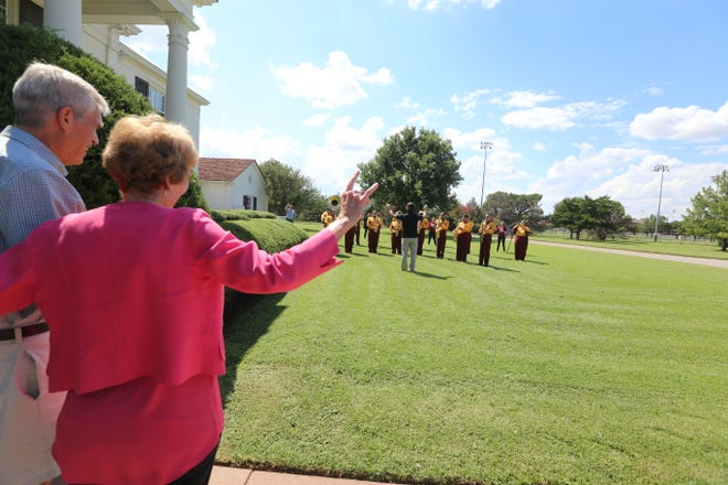 Suzanne Shipley and her husband Randy listen as members of the MSU band play the alma mater for the retiring university president at the Sikes House, Aug. 30, 2021. Shipley's last day is Aug. 31.