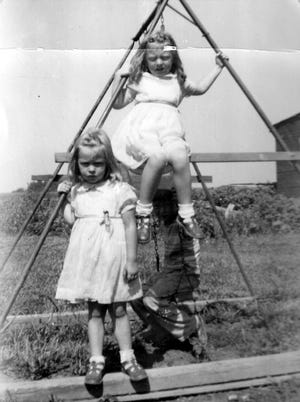 Susan seated and her sister Karen standing. Cousin George is in the background.