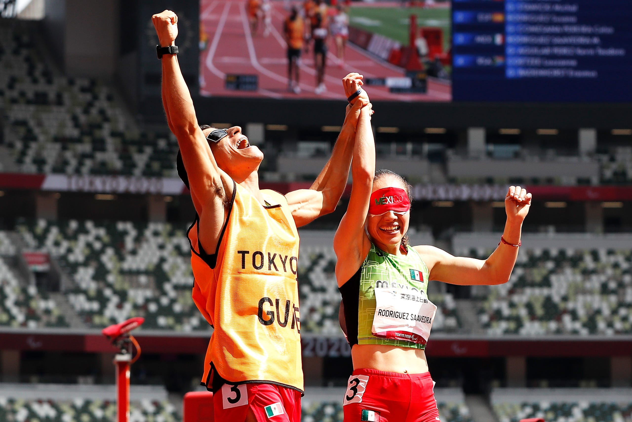 August 30, 2021: Monica Olivia Rodriguez Saavedra and guide Kevin Teodoro Aguilar Perez of Team Mexico react after winning the gold medal in the women's 1500m - T11 final on day 6 of the Tokyo 2020 Paralympic Games at Olympic Stadium in Tokyo, Japan.