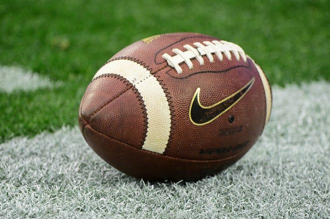 A football on the ground.