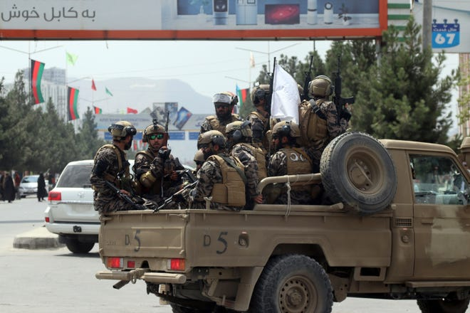 Taliban special force fighters arrive inside the Hamid Karzai International Airport after the U.S. military's withdrawal, in Kabul, Afghanistan, on Aug. 31, 2021. The Taliban were in full control of Kabul's international airport on Tuesday, after the last U.S. plane left its runway, marking the end of America's longest war.