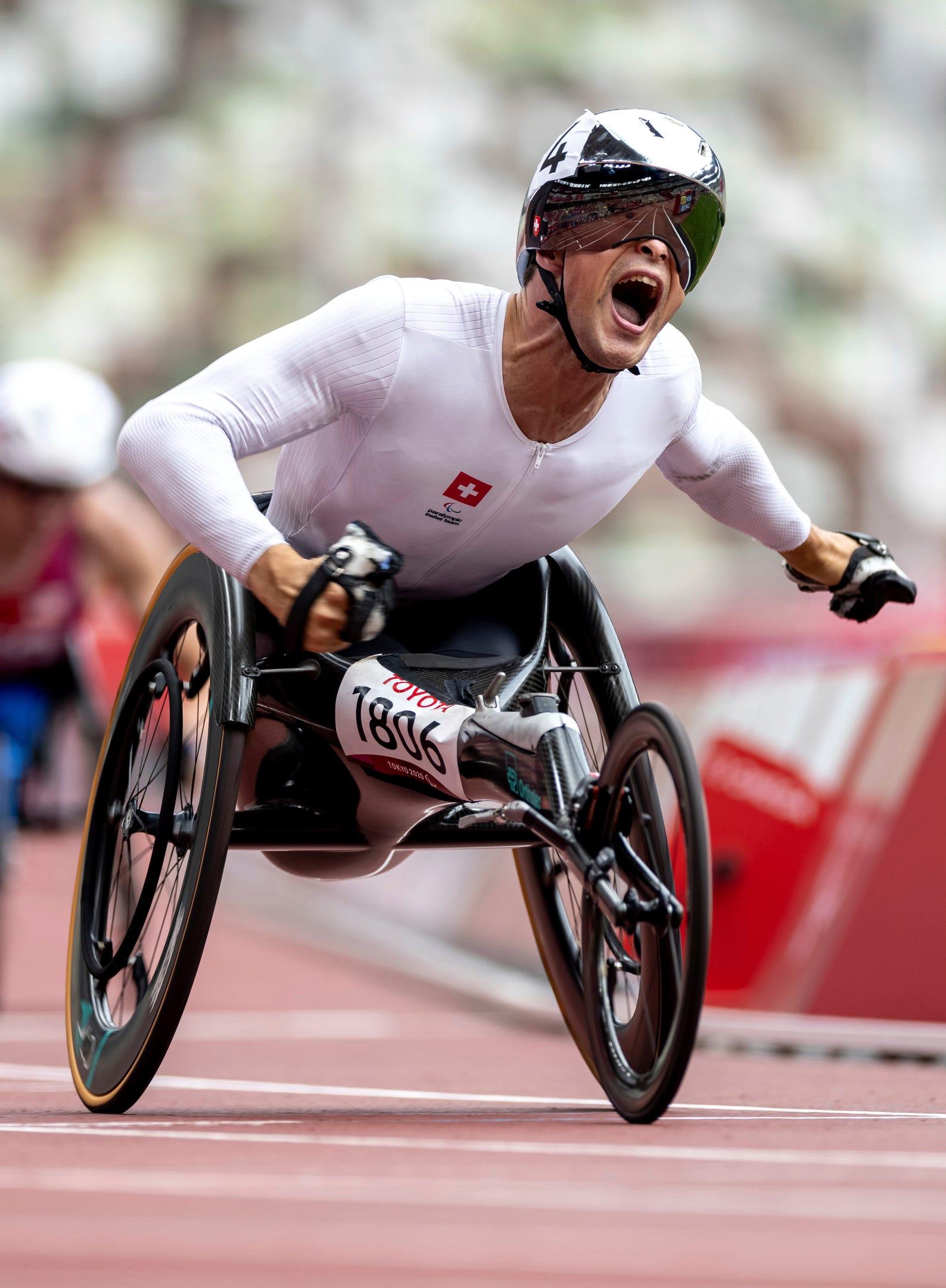 Aug. 31, 2021: Marcel Hug of Switzerland celebrates his gold medal finish in the Men's 1500-meter T54 Athletics Final.