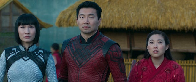 """Xialing (Meng'er Zhang), Shang-Chi (Simu Liu) and Katy (Awkwafina)  prepare to take on the Ten Rings army in mystical Ta Lo in """"Shang-Chi and the Legend of the Ten Rings."""""""