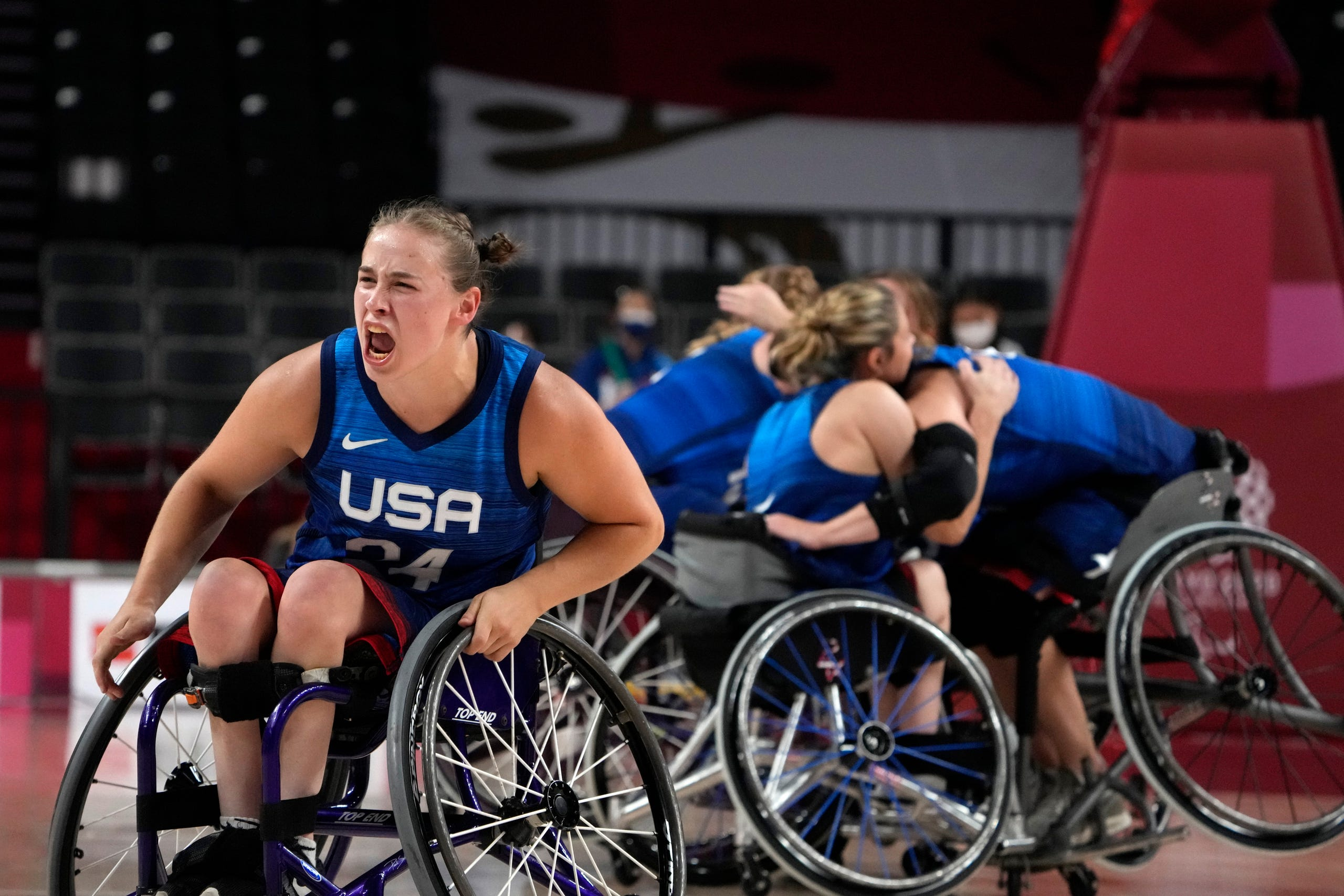 August 31, 2021: United States' Lindsey Zurbrugg, left, and her teammates celebrate as the United States defeated Canada in a women's wheelchair basketball quarterfinal game at the Tokyo 2020 Paralympic Games in Tokyo, Japan.