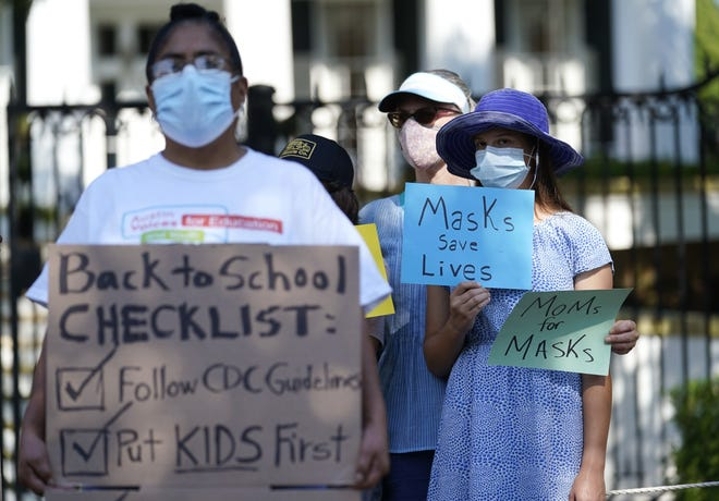 Students and parents gather outside the Governor's Mansion to urge Gov. Greg Abbott to drop his opposition to public school mask mandates, Monday, Aug. 16 in Austin. [AP PHOTO/ERIC GAY]