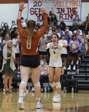 Westwood's Lola Fernandez, right, celebrates with her teammates after winning game two against Westlake in nondistrict action Tuesday at Westwood High School. Westwood rallied late in the fifth set to claim a 3-2 win.