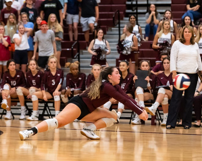 Madi Licht extends for a pass for Round Rock against Rouse Aug. 31 at Round Rock High School. Round Rock edged the Raiders in each set while winning 3-0.