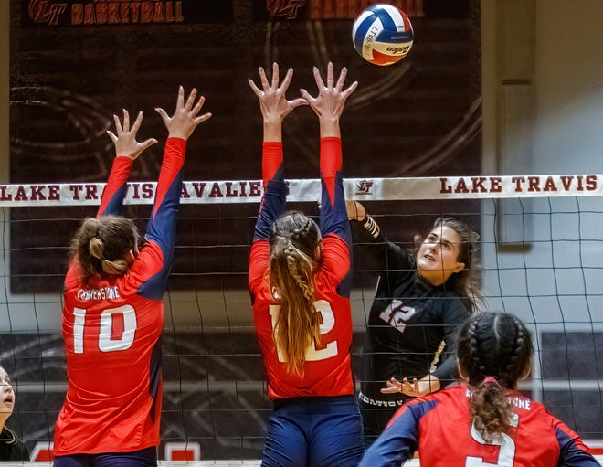 Lake Travis outside hitter Arden Besecker, right, fires a kill during the third set against Cornerstone Christian at the nondistrict volleyball game on Aug. 31 at Lake Travis High School. Lake Travis held on to win the 5-set thriller.