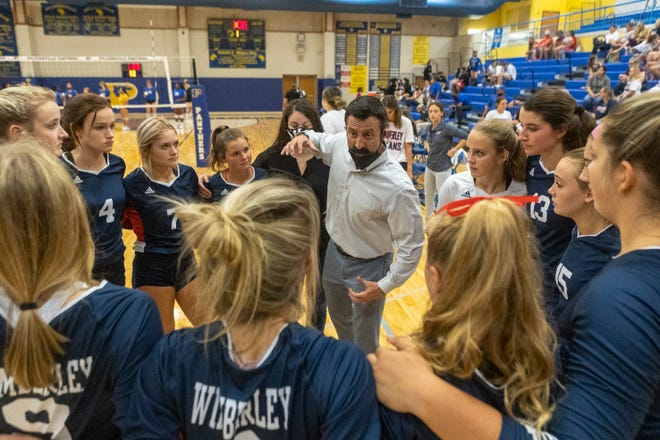Wimberley assistant coach Roberto Frontera speaks to his team during a nondistrict volleyball match against Pflugerville at Pflugerville High School on Tuesday. With head coach Stephanie Barthels missing the match, Frontera served as the head coach in Wimberley's win.