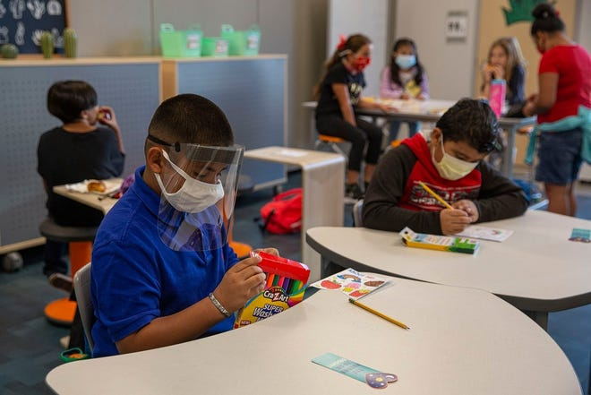 More than 50 school districts have defied Gov. Greg Abbott's ban on mask mandates, including the Austin district, amid a rise in coronavirus infections and hospitalizations,including among children. [MIKALA COMPTON/AMERICAN-STATESMAN]