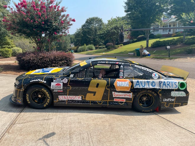 Mary Frances Webb sits in the car of NASCAR drive Chase Elliott. Through a contest benefiting Children's Healthcare of Atlanta, Webb's paint scheme was selected for Sunday's Cook Out Southern 500.