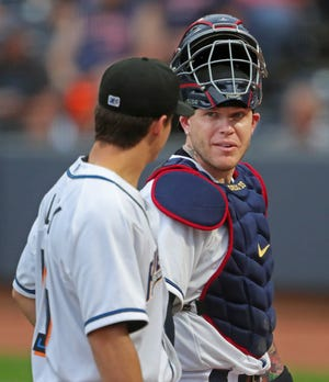 Cleveland catcher Roberto Perez, facing, chats with RubberDucks starting pitcher Logan Allen on their way back to the dugout during the first inning of Tuesday night's game against the Altoona Curve at Canal Park. [Jeff Lange/Beacon Journal]