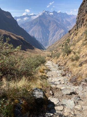 Looking back, the 26-mile Inca Trail is rugged as far as the eye can see in Peru.