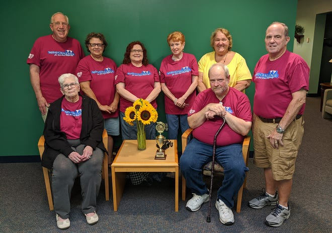 """A team of seniors representing Twinsburg and the Twinsburg Senior Center recently took third place in this year's Mind Challenge for the New Majority.  Pictured are, sitting, Maureen Cavotta and Bill Dixon; and standing, Mind Challenge organizer Phil Levine, Sandy Hansen, Maribeth Kralik, Catherine """"Kay"""" Ruth, Joan Vitale, and Mind Challenge organizer Art Greenberg."""
