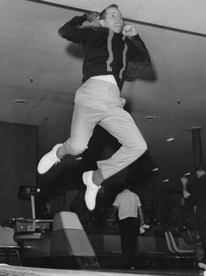 """Harry """"Tiger"""" Smith jumps for joy after rolling a strike in April 1965 before the Firestone Tournament of Champions at the Akron Bowlarama in Copley."""