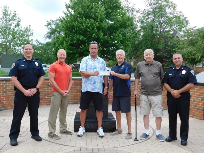 Robert Heeman (third from left), a Cuyahoga Falls High School alum, recently donated $2,000 to the Cuyahoga Falls & Silver Lake Police Memorial & Honor Guard Foundation. Pictured at the police memorial are, from left: Cuyahoga Falls Police Capt. Chris Norfolk, Mayor Don Walters, Heeman, Foundation Chair Steve Amos, retired Cuyahoga Falls Police Lt. Mark Wiggins, and Cuyahoga Falls Police Capt. Todd Shafer.