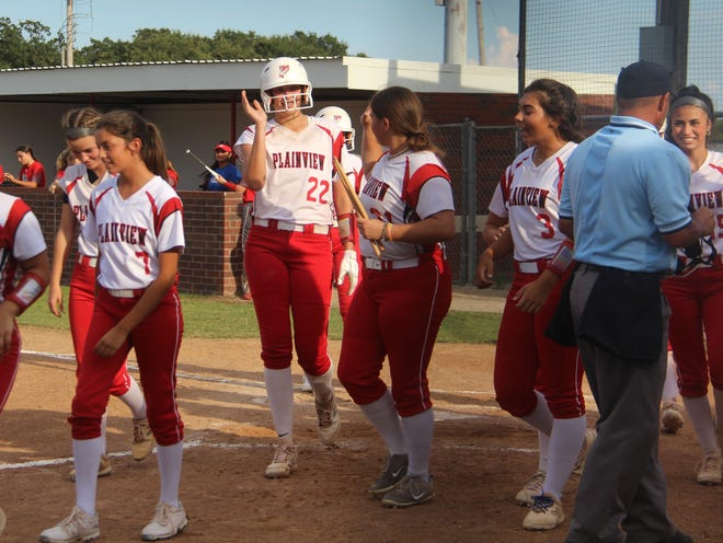 Plainview's Riley Grant (22) celebrates with her teammates after hitting a two-run homer. The senior also tossed a one-hitter with 17 strikeouts in the 8-0 win over Sulphur