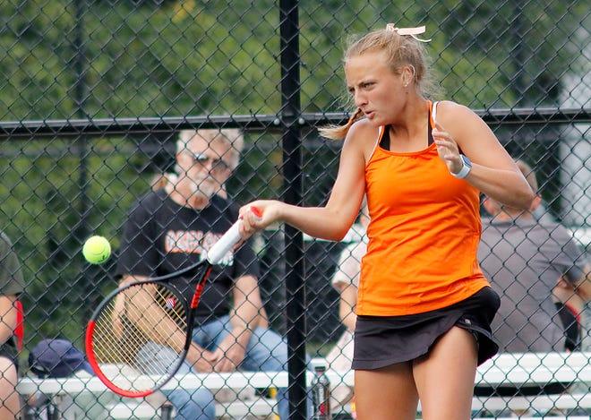 Ashland High School's Audra McBride returns a shot against Norwalk High School during their high school girls tennis match Wednesday, Sept. 1, 2021. TOM E. PUSKAR/TIMES-GAZETTE.COM