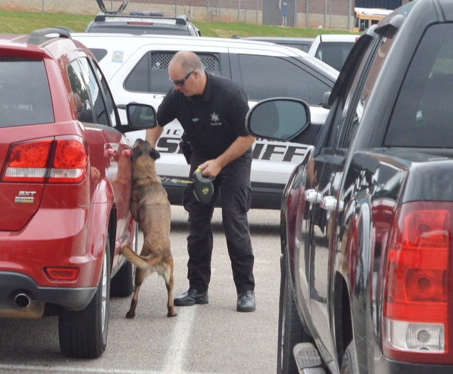 Richmond County K9 units search vehicles in the student parking lot at Jefferson County High School. Officers confirmed all they found were lighters and vape pens.