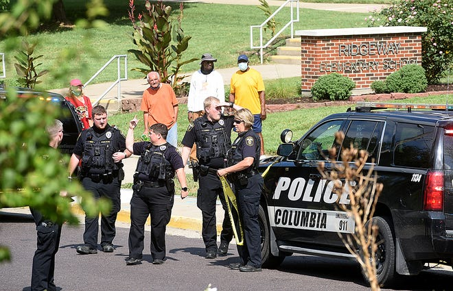 Columbia police prepare to string crime scene tape in the 200 block of East Sexton Road near Ridgeway Elementary School where a 17-year-old girl was shot during an apparent drive-by shooting at about 10:51 a.m. Wednesday. The woman was transported to a Columbia hospital.