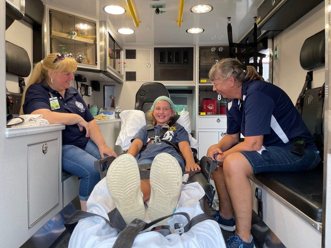 """LeeAnn Braman and Beth Fahnestock of the Penn Yan Area Volunteer Ambulance Corps with """"patient"""" Marlina Dick."""