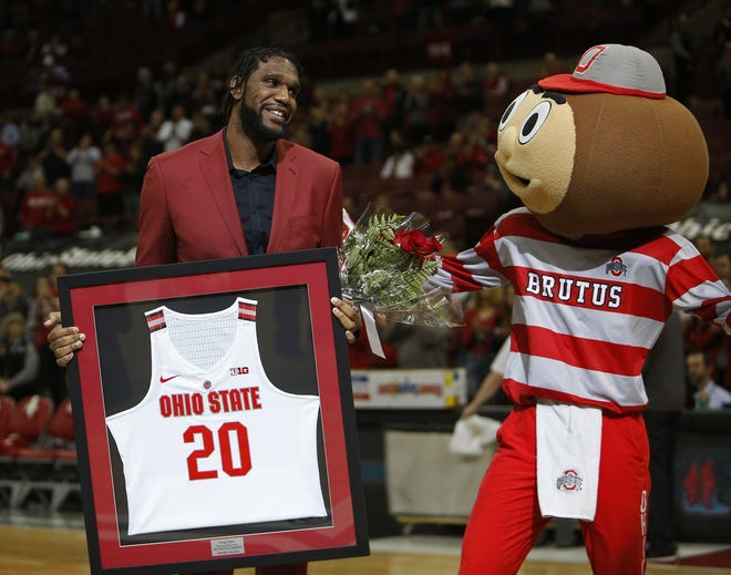 Former OSU basketball player Greg Oden celebrates senior day after graduating from OSU  at Value City Arena March 10, 2019.[Eric Albrecht/Dispatch]