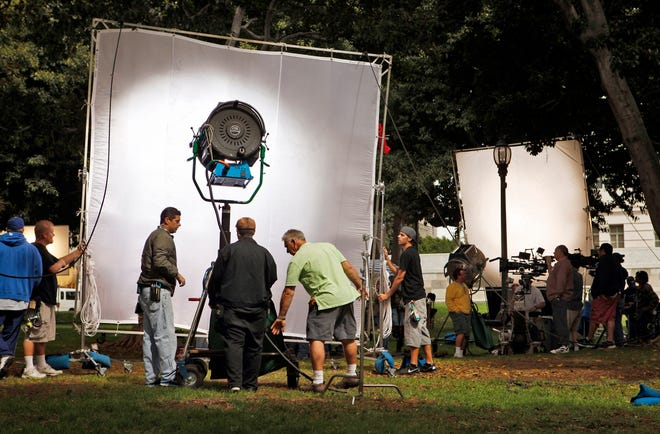 """A film crew sets up lights and cameras for shooting the second episode and finishing the pilot for the television series """"Franklin & Bash"""" on the lawn of Los Angeles City Hall on Tuesday, October 5, 2010. (Al Seib/Los Angeles Times/TNS)"""