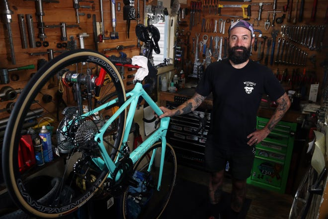 Mason Morgan, Westerville Bike Shop owner, is shown inside his store Aug. 26 at 29 W. Main St. in Westerville. The shop has been in business since 1973.