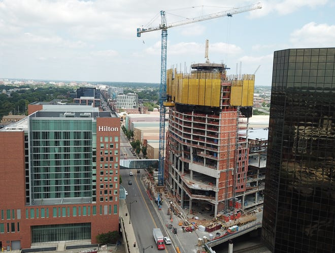 Work continues on the 28-floor, 460-room expansion of the Hilton hotel at the Greater Columbus Convention Center on North High Street, even as the construction industry faces worker and materials shortages.