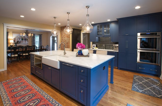 A new kitchen designed for an older Medick Estates home by architect Jamee Parish melds the vintage elements of the house with fresh upgrades to fit the homeowners' modern lifestyle.