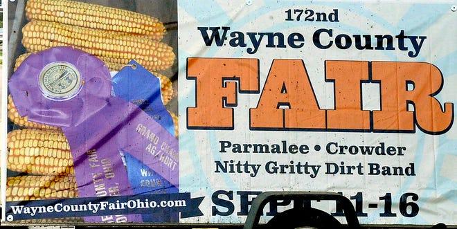 A Wayne County Fair sign.