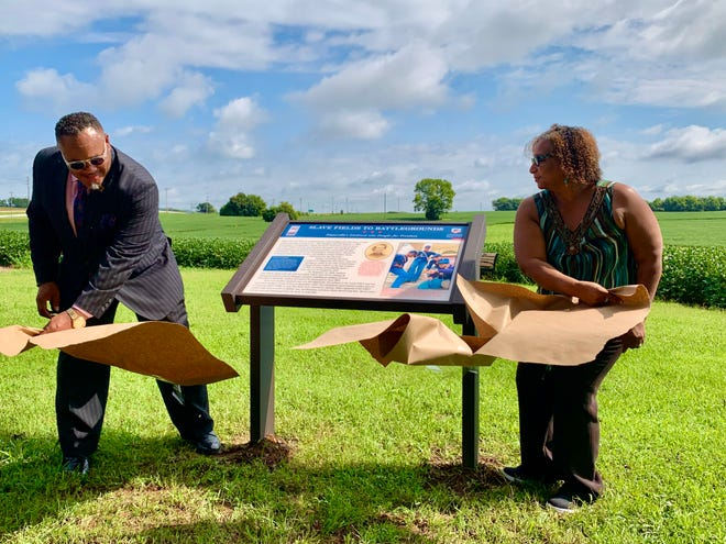 Pastor Chris Williamson and Cornelia Gipson unveil the new historical marker at Rippavilla honoring its former enslaved who later fought for the U.S. Colored Troops in 1863 and 1864.