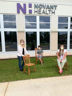 Blythe Leonard, (from left) Jane Murphy and Payton Williams display a few of the chairs that members of the Novant Health Thomasville Medical Center Foundation's Mammography Steering Campaign Committee will help Leonard paint pink for The Big Pink Chair Project fundraiser. The fundraiser, organized by Leonard, will raise money to provide free mammograms for uninsured women.