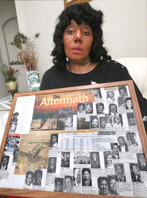 """Ophelia Beier, of Palm Coast, is a survivor of the terrorist attack on the Pentagon on Sept. 11, 2001. She is holding photographs of co-workers killed on that day. """"Despite our shared grief in the aftermath of 9/11, hope, resilience, prayer, and unity lifted us up as a nation,"""" Beier writes. """"Twenty years later, these lessons are more important than ever."""""""