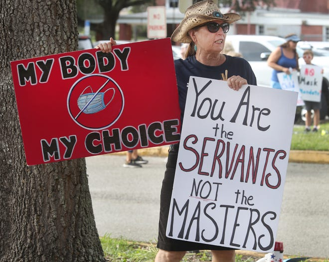 An anti-mask protester outside the Volusia County School Board last month. Controversies over mask mandates and the teaching of Black history promise to make for harsher-than-usual school board races next year and some in the Legislature want bring back partisan elections.