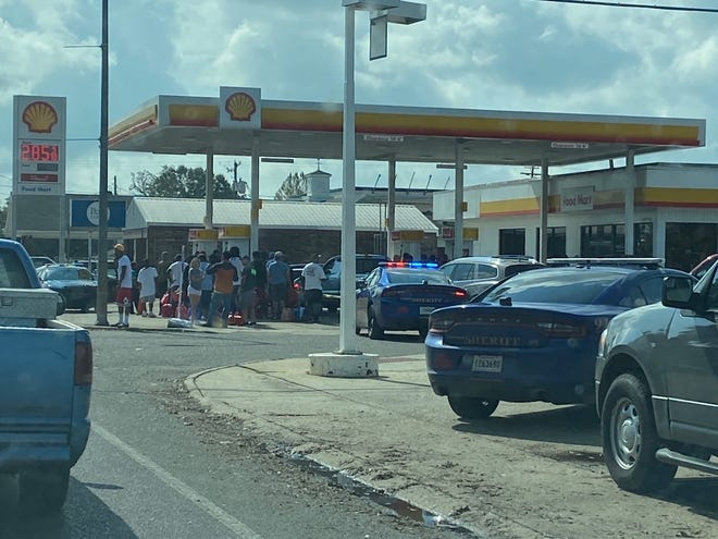 A long line forms at the Shell station in Donaldsonville.