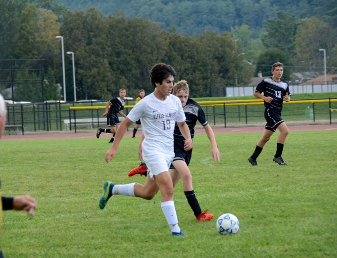 Alfred-Almond's Brennan Lang (19) pushes the pace against Jasper-Troupsburg in Addison Tuesday night.