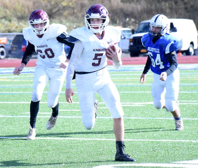 Jeffrey DeSarro (5) runs with the ball for the Frankfort-Schuyler Maroon Knights during a semifinal Section III playoff game against Dolgeville prior to winning the Class D championship in 2019. DeSarro graduated after playing the Fall II season with the Maroon Knights in the spring, and Frankfort-Schuyler has now canceled its fall season for 2021.