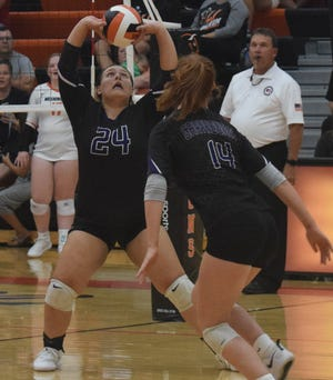 Burlington High School's Marissa Huff (24) puts up a set for teammate Adalyn Galbraith in the Grayhounds' 3-0 win Tuesday over the Demons at Washington in the Southeast Conference opener for both teams.