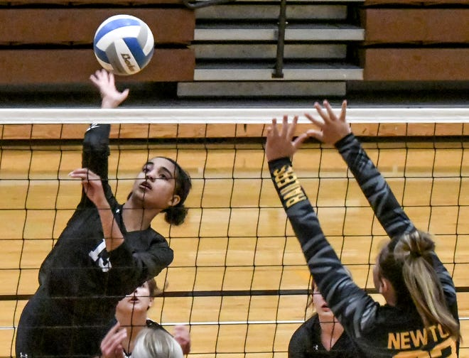 Garden City High School's Jennicah Pinchon makes a kill against Newton Tuesday during the Buffaloes home-opening volleyball triangular.