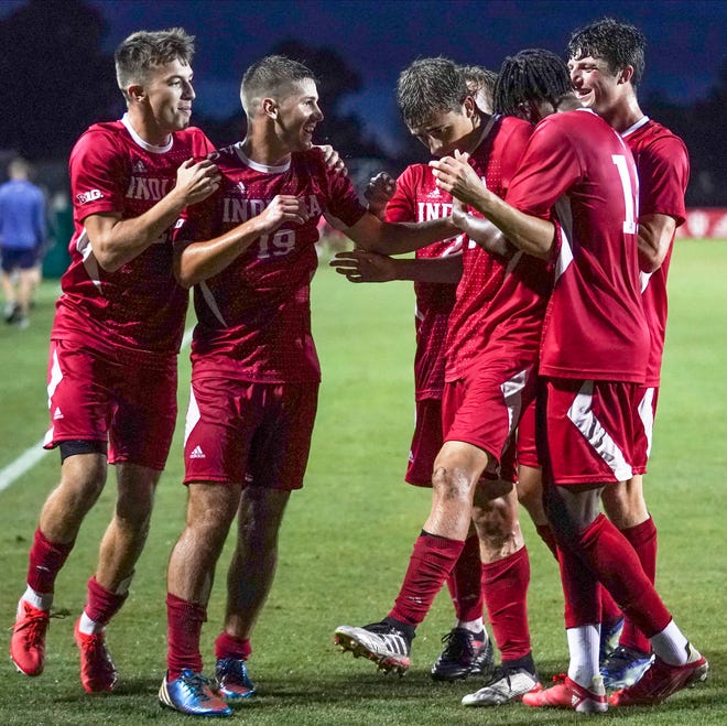 Indiana's Joey Maher (2) is congratulated by his teammates after scoring a goal during the match against Butler at Bill Armstrong Stadium Tuesday evening. (Bobby Goddin/Herald-Times)