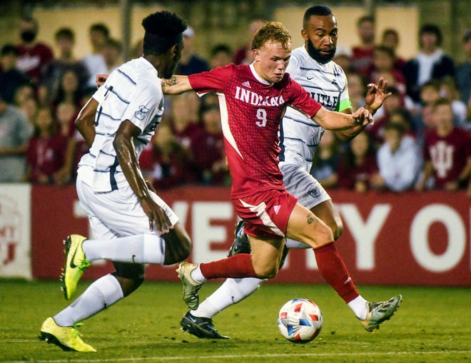Indiana's Samuel Sarver (9) dribbles upfield against Butler's Rhys Myers (25) during the match against Butler at Bill Armstrong Stadium Tuesday evening. (Bobby Goddin/Herald-Times)