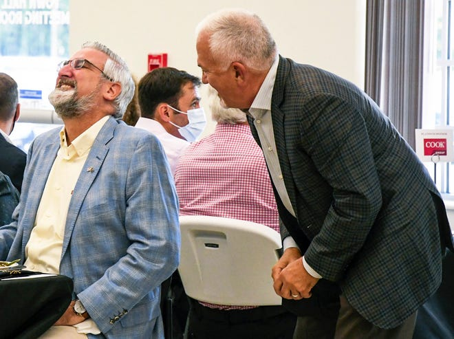 Gov. Eric Holcomb shares a moment with Dan Peterson, vice president for industry and government affairs at Cook Medical, during a luncheon Tuesday at the Ellettsville Town Hall.