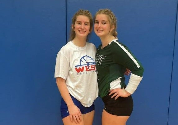 Twin sisters Payton Brown of West Henderson, left, and Olivia Brown of East Henderson pose before Tuesday night's volleyball match at West.