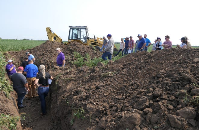 DeAnn Presley, Ph.D., a professor at Kansas State University explains to agronomists and farmers about 30,000-year-old soil that is located in the depths of Kansas cropland on Aug. 31, 2021 on Flickner Innovation Farm in McPherson County.
