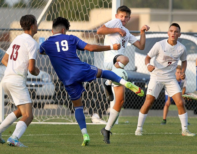 Hutchinson's David Reyna (19) and Buhler's Jaden Kretzer (16) battle for the ball during their game Tuesday, Aug. 31, 2021, at the Salthawk Sports Complex. Hutchinson defeated Buhler 3-2.