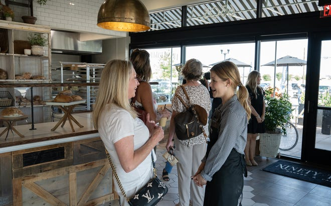 Guests visit with the staff at Ninety-Two Bakery & Cafe following Wednesday's ribbon cutting for the new business located at 6303 82nd St.